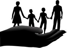Mother father kids family safe secure in hand. Family of mother father children held in a cupped hand symbol of security safety Stock Images