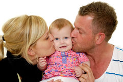 Mother and father are kissing baby Royalty Free Stock Photography