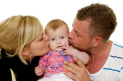 Mother and father are kissing baby Stock Photo