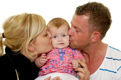 Mother and father are kissing baby Stock Image