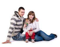 Mother, father and little girl. Isolated on whit Royalty Free Stock Photography