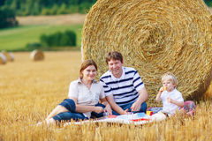 Mother, father and little son, kid boy having picnic Royalty Free Stock Images