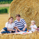 Mother, father and little son, kid boy having picnic Royalty Free Stock Image