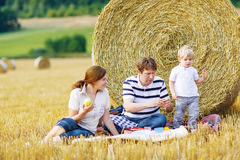 Mother, father and little son, kid boy having picnic Stock Photography