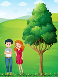 A mother and a father near the big tree at the hilltop stock illustration