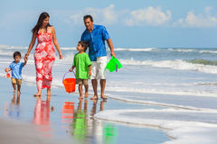 Mother Father Parents Boy Children Family Beach Fun. A happy family of mother, father parents & two boy son children, playng and having fun in the waves of a Royalty Free Stock Photography