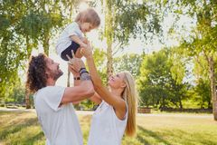 Happy family playing in the park. Royalty Free Stock Image