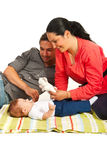 Mother and father play with their kid Stock Photos