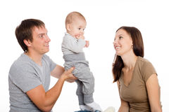 Mother and father playing with his son. Joyful mother and father playing with his little son. Child seven months stock photos