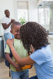 Mother and father prepare his son to going at school Stock Photos