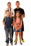 Mother father and schoolkids isolated over white background Stock Photography