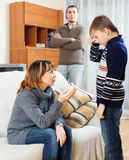 Mother and father scolding  son at living room Stock Photos