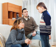 Mother and father scolding teenager son Stock Photography