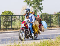 Mother, father and small child on a motorbike Stock Images