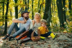 Mother father and small son picnic. Picnic in nature. Vacation and tourism concept. Happy family with kid boy relaxing stock image