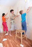 Mother with father and son break wallpapers from. The wall Stock Photography