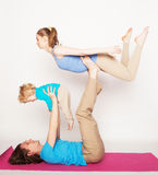 Mother, father and son doing yoga Stock Image