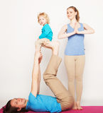 Mother, father and son doing yoga Royalty Free Stock Images