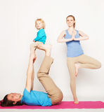 Mother, father and son doing yoga Stock Photography