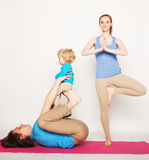 Mother, father and son doing yoga Royalty Free Stock Photos