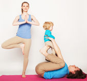 Mother, father and son doing yoga Royalty Free Stock Image