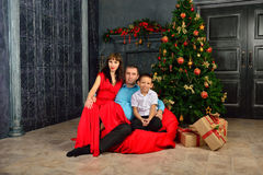 Mother, father and son in a New Year's interior Royalty Free Stock Image