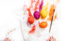 Mother, father and son are painting eggs. Happy family are preparing for Easter. Coloring eggs for Easter with colorful bright colors, the hands of a baby, a stock images