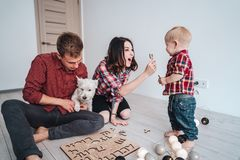 Happy family are playing together on the floor. A mother, father and son are playing together on the floor Royalty Free Stock Photography