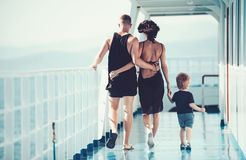 Mother and father with son in sea trip. Family ship travel with kid on mothers or fathers day. Child with father and stock photo