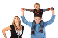 Mother and father with son on shoulders Stock Photography