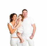 Mother, father and their child together in studio Stock Image