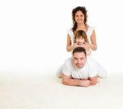 Mother, father and their child together in studio Stock Photos