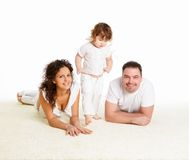 Mother, father and their child together in studio Royalty Free Stock Photo