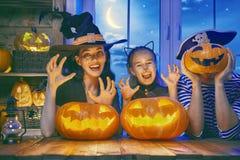 Family celebrating Halloween Stock Photos