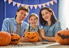 Family preparing for Halloween. Royalty Free Stock Image