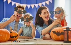 Family preparing for Halloween. Royalty Free Stock Photo