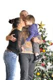 Mother, the father and their small child stand near Christmas tree Royalty Free Stock Photos