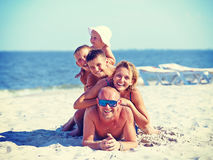 Mother and father with three children on the beach. Royalty Free Stock Photography