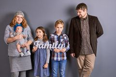 Mother, father and three kids. royalty free stock images