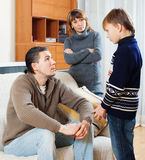 Mother and father together scolding  son Royalty Free Stock Image