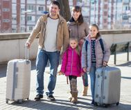 Family with suitcases in journey Royalty Free Stock Photo