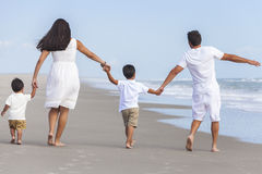 Mother, Father & Two Boy Children Family Walking on Beach Stock Photos