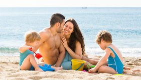 Mother and father with two kids Stock Images