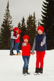 Mother, father and two sons having fun in snow winter Royalty Free Stock Photography