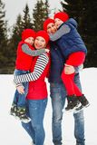 Mother, father and two sons having fun in snow winter Royalty Free Stock Photos