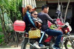 Pengzhou, China: Family on Motorcycle Royalty Free Stock Images