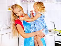 Mother  feed child at kitchen. Stock Image