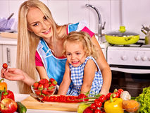 Mother  feed child at kitchen Royalty Free Stock Image