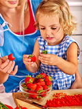 Mother feed child at kitchen Royalty Free Stock Photo