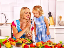 Mother  feed child at kitchen Royalty Free Stock Photography
